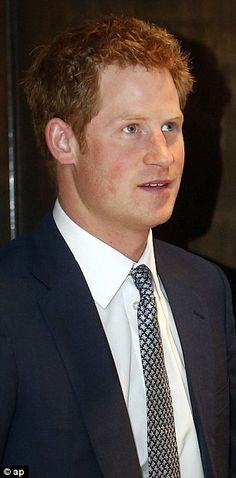 Lofty: Prince Harry, who stands at 6ft 2ins tall, caught the eye of Miss USA Nana Meriweather