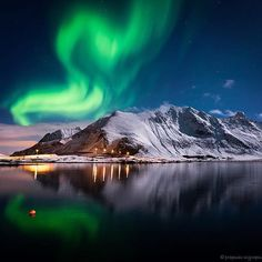 Swirling curves lightshow By @totasigth_photography  Location: Lofoten, Norway #ilovenorway