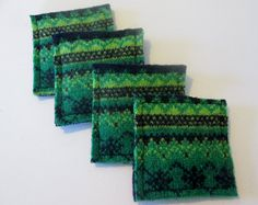 Wow your guests and protect your tables and counters with this set of four fun, yet functional coasters. these coasters will look great anywhere in your home. They may look delicate but because of the felting process they are now a thick durable fabric measuring 4. inches across.  I put hot pans and tea/coffee cups right on mine. Not only for cups and pans...you can put plants and candles on them as the felted wool will protect you tables from water and heat. A great stand alone piece of…
