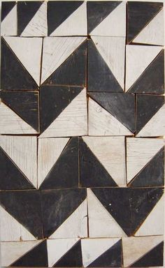 Tribal, 1996  Black and white painted wood (from cable drums)  75.2 × 47.5 × 2.3cm