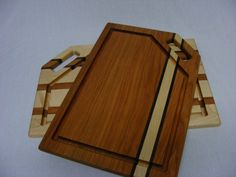 Paul's Specialties: Paul Estler of Huntington, WV crafts functional items from local West Virginia hardwoods as well as reclaimed wood from homes and barns … Check out the attractive cutting boards available in several designs and shapes, lazy susans, coat racks, wine bottle and glass holders, and more. Great for gifts! #WestVirginia