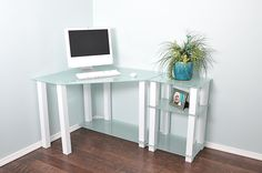 "This modern corner desk features a white tempered glass to and sturdy squared aluminum legs for a clean, elegant look. The lower shelf for storage and the included 20"" extension table that can be plac"