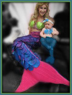 Baby Emma enjoying meeting another mermaid at SeaWorld Orlando's Halloween Spooktacular
