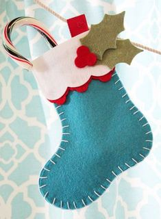 MFT Felt Stockings - how cute, small for tree decorations and larger for gift holdersIt's time for the Creative Challenge from My Favorite Things. The MFT Design Team Creative Challenge is a monthly feature, where we are challenged to explore our cre Felt Christmas Stockings, Felt Stocking, Felt Christmas Decorations, Felt Christmas Ornaments, Tree Decorations, Felt Crafts Diy, Christmas Projects, Holiday Crafts, Christmas Sewing