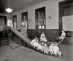 "Washington, D.C., circa 1921. ""Foundling Hospital, playroom."" Tots at the Washington Asylum for 'Foundlings'"