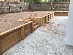 Building A Deck 452541462555584417 - Cypress post and sleepers retaining walls with built in decked stairs Source by Marylapollueuse Cheap Retaining Wall, Sleeper Retaining Wall, Retaining Wall Steps, Backyard Retaining Walls, Building A Retaining Wall, Sloped Backyard, Sloped Garden, Backyard Landscaping, Railroad Tie Retaining Wall