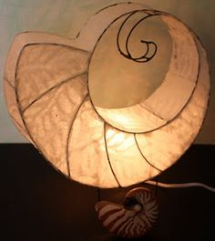 Paper and wire light - by Tory Brokenshire