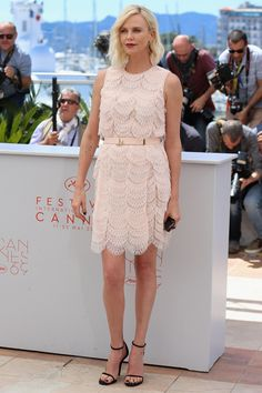 20 May Charlize Theron wore a pretty scalloped Givenchy dress to attend the photocall for The Last Face.   - HarpersBAZAAR.co.uk