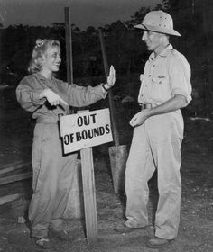 Lieutenant Virginia Crelli at a field hospital, informing Red Cross correspondent George L. Moorad that he cant enter the nurses quarters, during the Pacific Campaign of World War Two, Papua New Guinea, circa 1943-1945. (Photo by European/FPG/Getty Images)