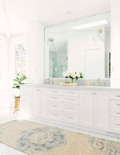A beige and blue vintage rug sits on marble floor . A beige and blue vintage rug sits on marble floor . Bathroom Floor Tiles, Bathroom Rugs, Tile Floor, Small Bathroom, Master Bathroom, Bathroom Black, Vanity Bathroom, Bathroom Colors, Washroom