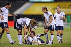 Sydney Leroux on the ground after being mauled by Megan Rapinoe (also on the ground) in celebration of Leroux's goal against New Zealand, Oct. 30, 2013. (Jamie Sabau/Getty Images North America)