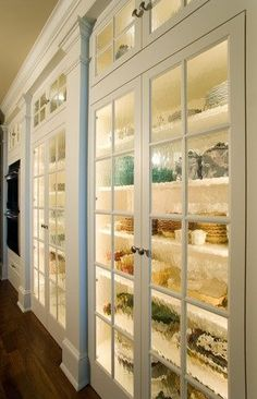 Kitchen Glass Cabinets..... Looove using glass on cabinet doors!!! Loooove displaying my collection of french cook ware, etc.