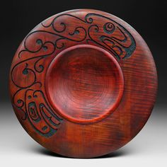 Douglas J Fisher . nice idea of something to do to a plain wooden bowl. I have a Dremel...might as well use it!