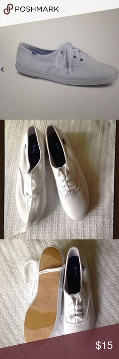 NWOB Ked's white canvas sneaker size 7 New white canvas upper, 4 eyelet lace up, soft breathable lining, cushioned insole, flexible outsole. In great condition other than a little dust from being store in the closet Keds Shoes Slippers
