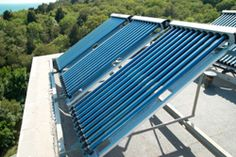 vacuum solar water heating system on the house roof. Solar Panel Cost, Solar Panels For Home, Solar Panel System, Landscaping Near Me, Landscaping Software, House Roof, My House, Solar Water Heating System, Industrial Vacuum