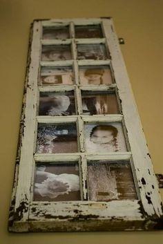 Photos behind an old window frame.