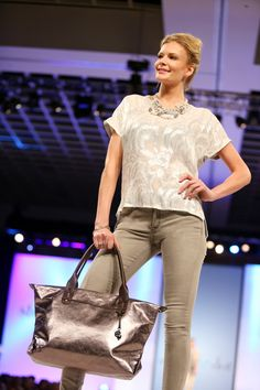 Model wearing Stella & Dot Oslo Necklace and How Does She Do It Bag in pewter metallic, all from our Fall 2013 Collection.
