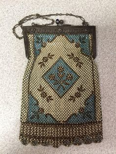 Beautiful Mandalian Enamel Silk Lined Mesh Purse in blue/beige/brown colors, blue stone kiss clasp with three rosettes across frame signed on inside.
