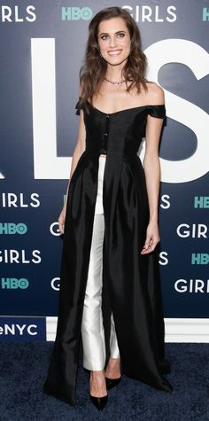 A dress? Or pants? Allison Williams chose both for the premiere of HBO's Girls with a black off-the-shoulder gown that opened at the waist to reveal a pair of slim white pants underneath—a look by Gabriela Hearst, the most recent winner of the prestigious International Woolmark Prize—finishing her look with Fred Leighton jewelry and black patent Louboutin pumps.