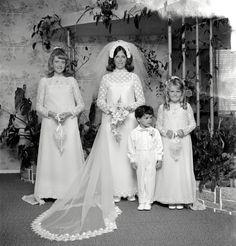 Bride, bridesmaid and children in wedding