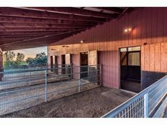 Horse barn with covered runs