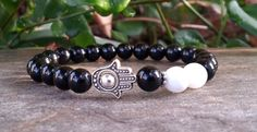 Check out this item in my Etsy shop https://www.etsy.com/listing/200786486/free-shipping-protection-hamsa-bracelet