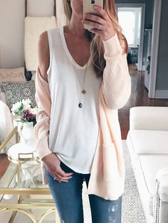 Everyone needs a plain white tank. Especially one like this. Love the v neck and that it's long and loose. spring outfit idea: peachy pink cardigan