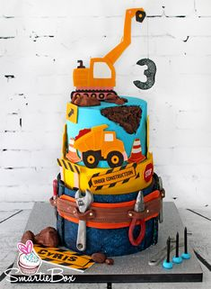 Construction theme cake with differs, tools etc - SmartieBox Cake Studio