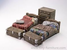 Two beds with the one chest of drawers and two chests.