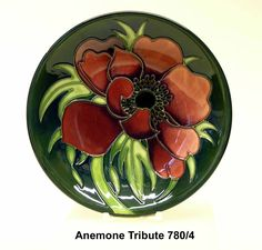 """In the centre is a tall """"Florian"""" vase of the type first produced under Atterbury, P. Moorcroft, B. (1993) Moorcroft: A Guide to Moorcroft Pottery 1897-1993. Description from vasekino.net. I searched for this on bing.com/images"""