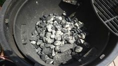 Minion method coal bed. 1/2 a starter chimney of lit coal, dumped in the middle of unlit lump charcoal.
