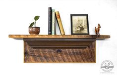 This beautiful rustic wooden mantel would make a great addition to any room of your house. It is handmade in our shop from reclaimed pine barn wood that has been carefully crafted, sanded, and sealed to create a shelf that is as beautiful as it is functional. This mantel features unique details such as authentic barn wood boards, historic victorian crown moldings, and beautiful grooved wood detailing. #bydadanddaughter #barnwood #mantel #entryway #rustic #home