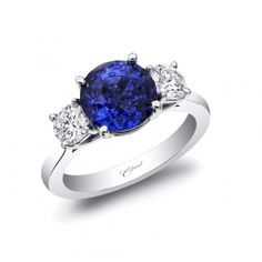 This classic ring from our Signature Collection boasts a 3.05CT Sapphire flanked by 2 exquisite round brilliant diamonds.