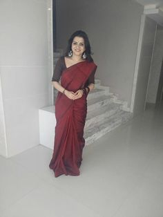 DD in a maroon saree