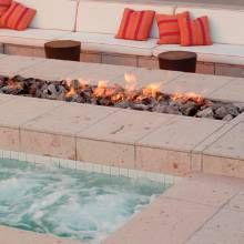 An elongated sitting area, fire pit and spa mimic the linear feel of the house.
