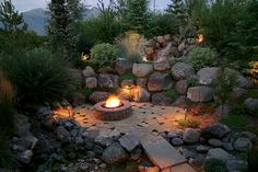 wow, what a difference a lil landscape lighting makes.. i love all the rock.