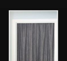 Cover unused door with tension rod and curtain to soften a room and hide the door.