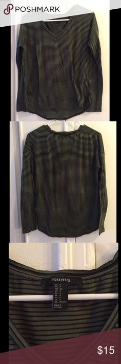 Forever 21 long sleeve striped tee Long sleeve olive green tee with black stripes. V neck and slight high low hem. Worn a few times but in very good condition. Forever 21 Tops Tees - Long Sleeve