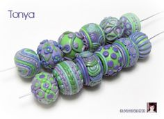 my FAVE! purple & green #polymer clay beads by @Leah Hagan