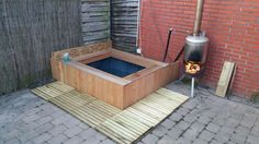 http://www.klusidee.nl/Forum/houtgestookte-jacuzzi-hottub-van-ibc-container-t97750.html