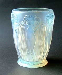 DANIAIDES Lalique  A good example of the iconic water carriers design in opalescent glass with blue staining . Date c1930. Signed in script to the base base.