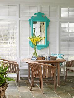 A colorful mirror brings the happy to this inviting space.