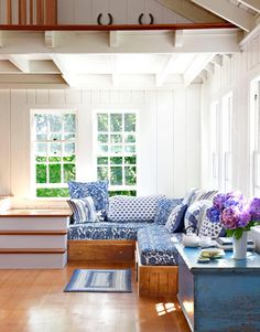 Cushions sewn from table linens adorn this built-in daybed. Such a cozy corner! #decorating
