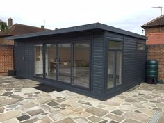 Combination summer house painted in 'Anthracite' and featuring colour matching sliding doors