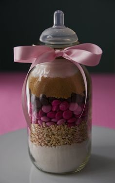 Baby Shower Favors- Baby food jars with new label to match shower theme, filled with pink M's and White yogurt covered pretzels. Description from pinterest.com. I searched for this on bing.com/images