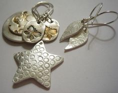 Beautiful jewellery pieces made from precious metal clay.  I would love to be able to make these.  I got these from Kate's Jewellery Making Blog and I regularly revisit this site just to gain inspiration.