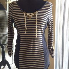 Tiny Brand Top with Gold Trim Henley top with gold trim, navy with cream stripes and slimming navy panels on sides. So cute and comfortable. Size L but could also fit M. In great condition. Anthropologie Tops