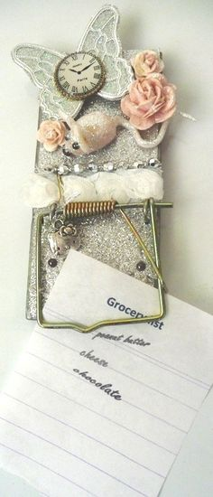 A glittered repurposed mouse trap?  Creative!  Mice everywhere are celebrating!