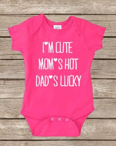 I'M CUTE, MOM'S HOT, DAD'S LUCKY Color: PINK Sizes: NEWBORN-24months Made with 100% cotton. Digitally printed with Direct To Garment technology (DTG) and/or heat transfer process with non toxic vinyl. We also use eco friendly water based ink. Baby stuff, baby clothes, funny onesies, ...