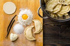 Homemade dumplings on a wooden table by Kamil Zabłocki on 500px